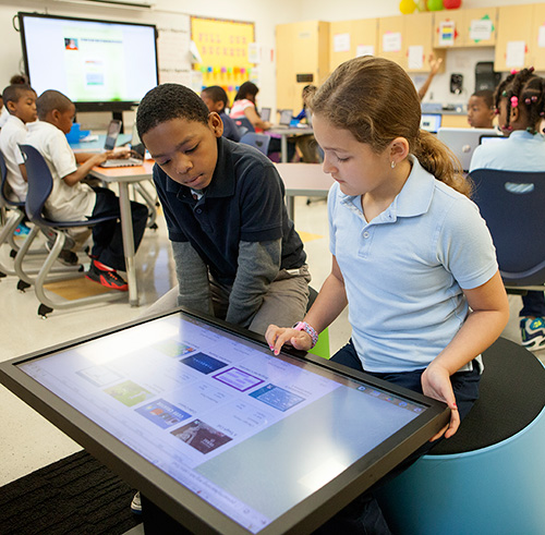 Students view lessons via a smart table